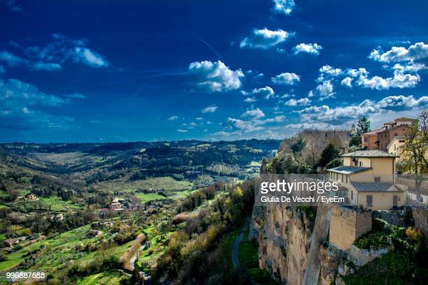 panoramic view of residential buildings against sky - orvieto stock pictures, royalty-free photos & images