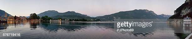 panoramic view of riva del garda after sunset - pjphoto69 ストックフォトと画像