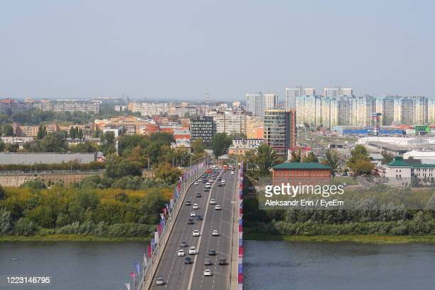 panoramic view of river and buildings in city against clear sky - ニジニ・ノヴゴロド ストックフォトと画像