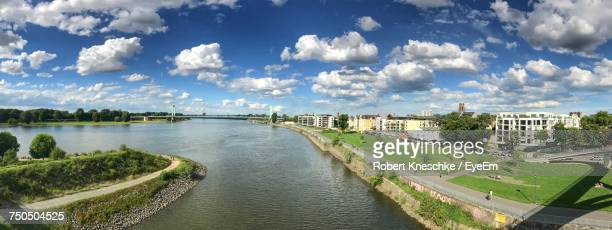 Panoramic View Of River By City Against Sky