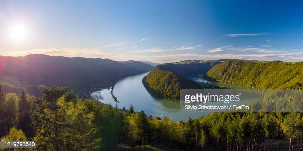 panoramic view of river, trees and plants against sky - upper austria stock pictures, royalty-free photos & images