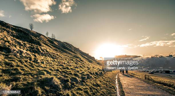 panoramic view of road against sky during sunset - country road stock pictures, royalty-free photos & images
