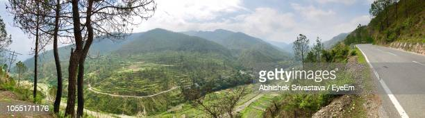Panoramic View Of Road Amidst Mountains Against Sky