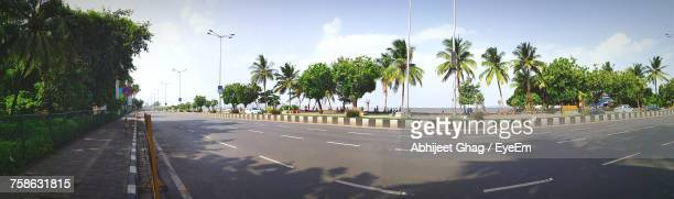 Panoramic View Of Road Amidst Trees Against Sky