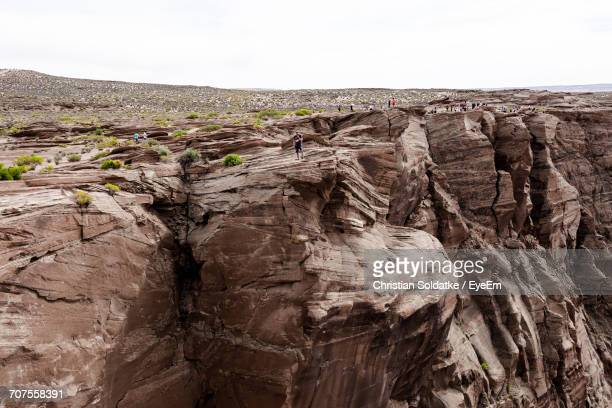panoramic view of rock formation against sky - christian soldatke stock pictures, royalty-free photos & images