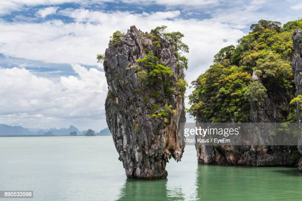 Panoramic View Of Rock Formation Amidst Sea Against Sky