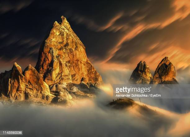 Panoramic View Of Rock Formation On Land Against Sky During Sunset