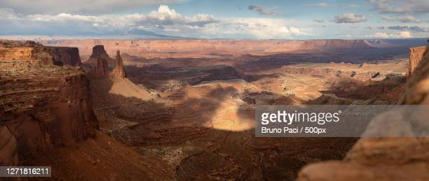 panoramic view of rock formations against cloudy sky, moab, united states - islands in the sky stock pictures, royalty-free photos & images
