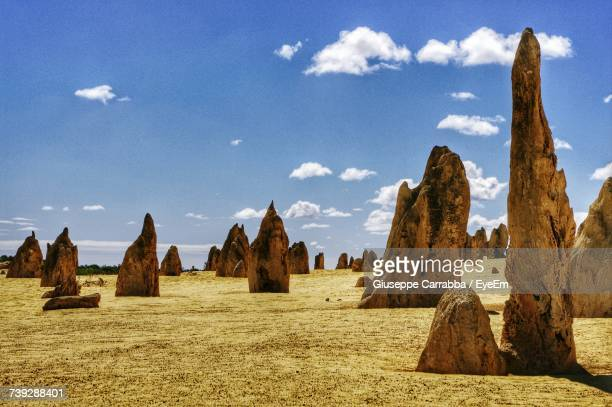 panoramic view of rock formations against sky - western australia stock photos and pictures