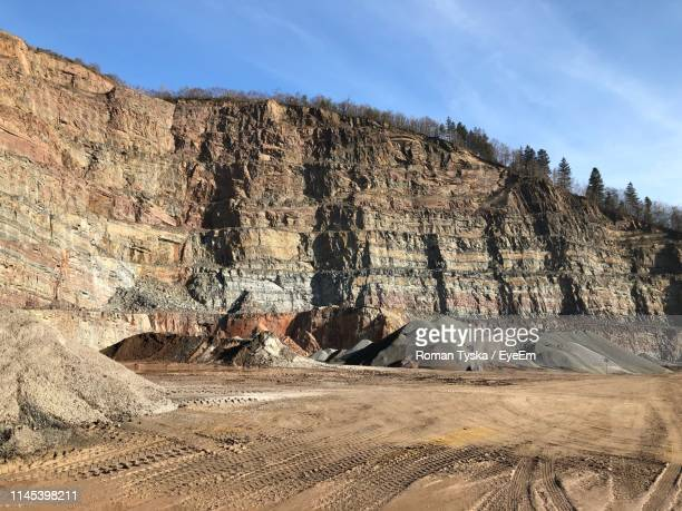 panoramic view of rock formations on land against sky - 石切場 ストックフォトと画像