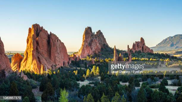 panoramic view of rocks and mountains against clear sky - garden of the gods stock photos and pictures