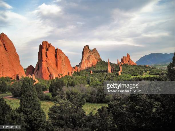panoramic view of rocks on landscape against sky - garden of the gods stock photos and pictures