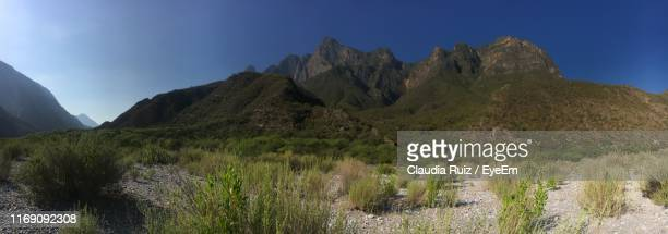panoramic view of rocky mountains against clear sky - nuevo leon stock pictures, royalty-free photos & images