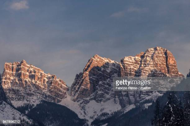 panoramic view of rocky mountains against sky during winter - fabrizio penso foto e immagini stock