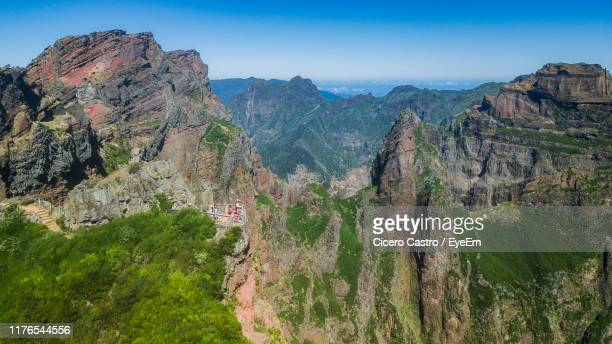 panoramic view of rocky mountains against sky - ilha da madeira imagens e fotografias de stock