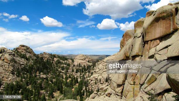 panoramic view of rocky mountains against sky - joel rogers stock pictures, royalty-free photos & images