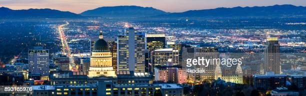 panoramic view of salt lake city at dawn - salt lake city utah stock photos and pictures