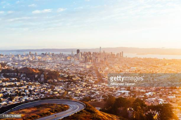 panoramic view of san francisco skyline at sunrise seen from twin peaks, california, usa - cityscape stock pictures, royalty-free photos & images