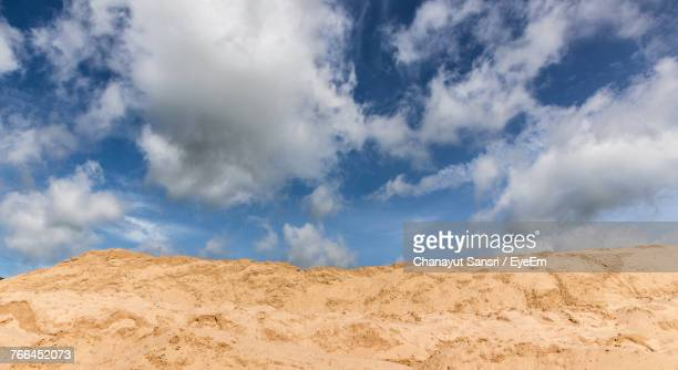 panoramic view of sand against blue sky - chanayut stock photos and pictures