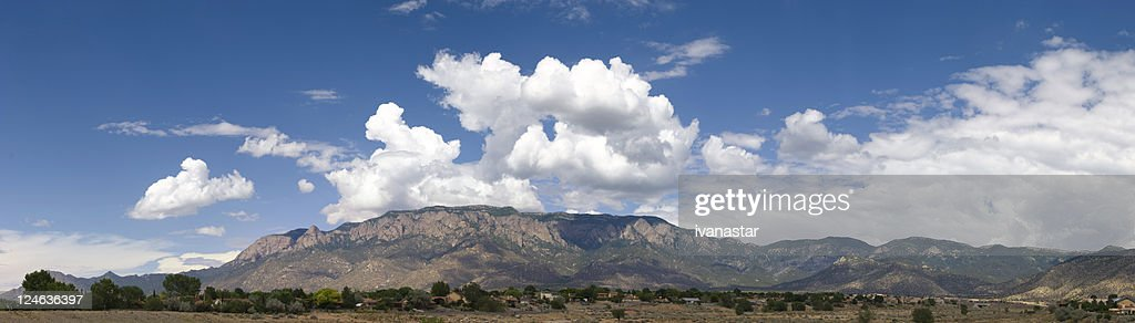 Panoramic View of Sandia Mountains with Blue Sky and Clouds : Stock Photo