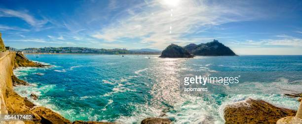 panoramic view of santa clara island and san sebastian coastline. donostia, basque country, spain - san sebastian spain stock pictures, royalty-free photos & images