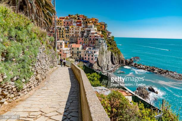 panoramic view of sea against blue sky - cinque terre stock pictures, royalty-free photos & images
