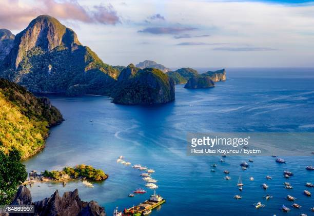 panoramic view of sea against blue sky - el nido stock pictures, royalty-free photos & images