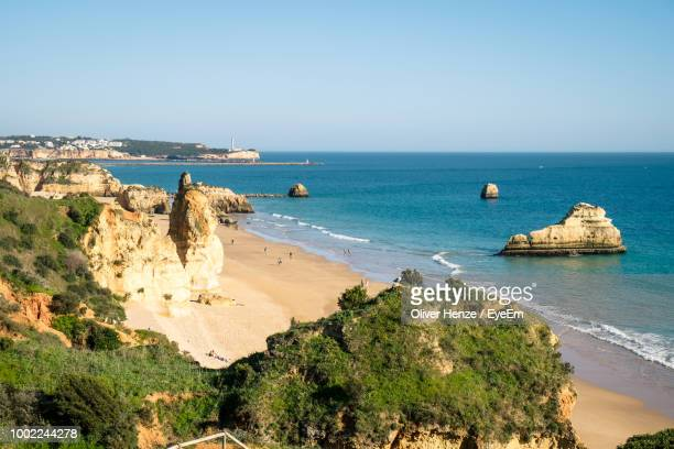 panoramic view of sea against clear sky - albufeira stock pictures, royalty-free photos & images