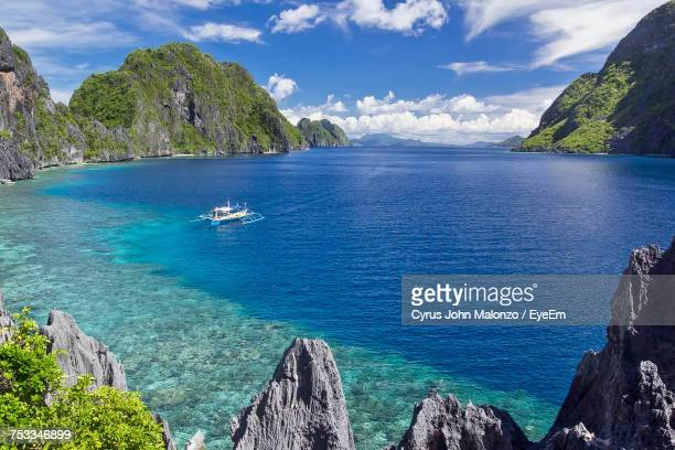 panoramic view of sea against cloudy sky - el nido stock pictures, royalty-free photos & images