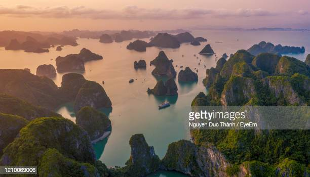 panoramic view of sea against sky during sunset - halong bay stock pictures, royalty-free photos & images