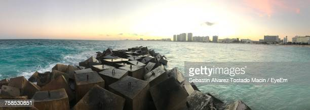 panoramic view of sea against sky during sunset - isla mujeres ストックフォトと画像