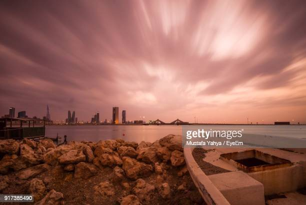 panoramic view of sea against sky during sunset - bahrain stock pictures, royalty-free photos & images