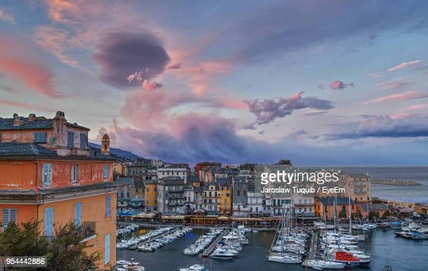 panoramic view of sea against sky during sunset - corsica stock-fotos und bilder