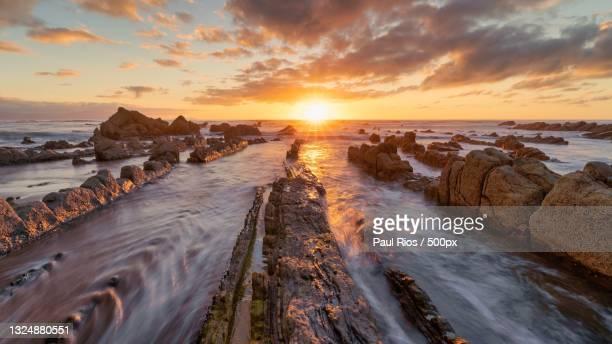 panoramic view of sea against sky during sunset,barrikako hondartza,bizkaia,spain - ビスカヤ県 ストックフォトと画像