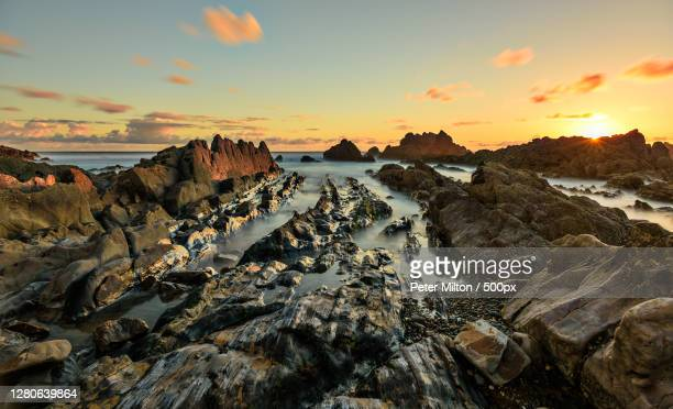 panoramic view of sea against sky during sunset,s w coast path,bude,united kingdom,uk - basal cell carcinoma stock pictures, royalty-free photos & images