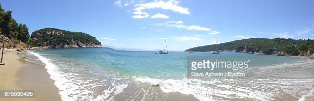 panoramic view of sea against sky on sunny day - dave ashwin stock pictures, royalty-free photos & images