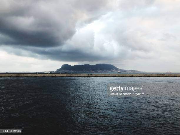 panoramic view of sea against sky - jesus calming the storm stock pictures, royalty-free photos & images