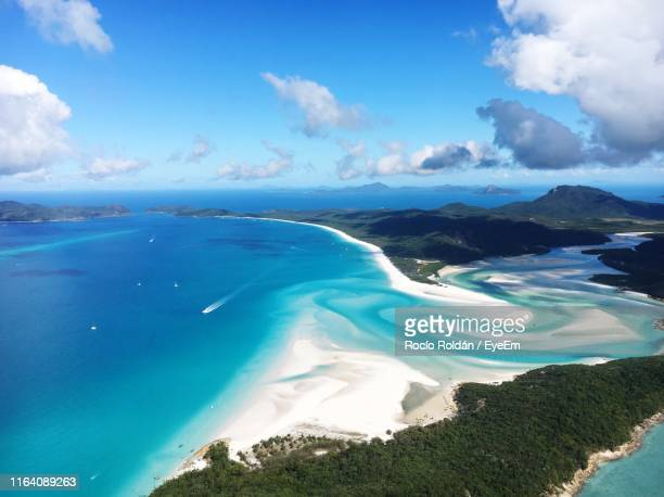 panoramic view of sea against sky - whitehaven beach stock-fotos und bilder