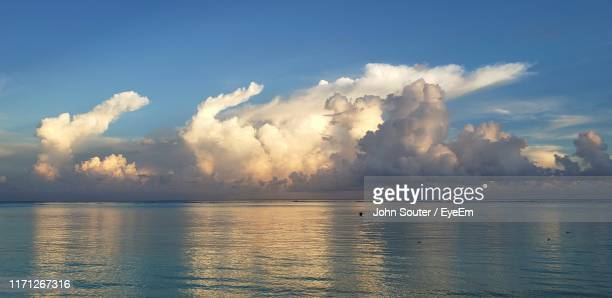 panoramic view of sea against sky - cumulus stock pictures, royalty-free photos & images
