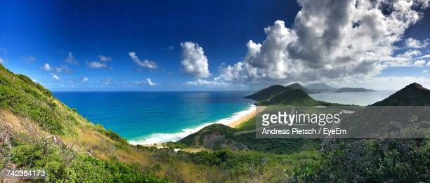 panoramic view of sea against sky - st. kitts stock photos and pictures