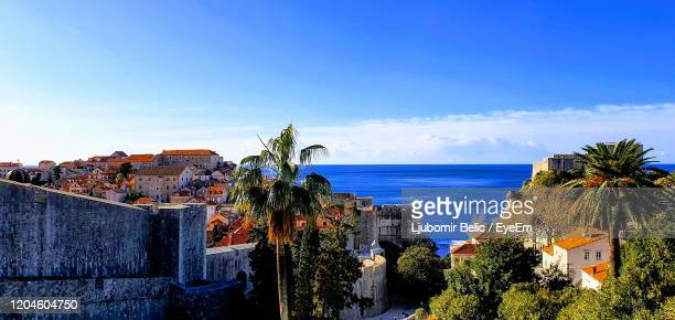 panoramic view of sea and buildings against blue sky - ljubomir belic stock pictures, royalty-free photos & images