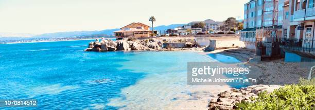 panoramic view of sea and buildings against clear sky - city of monterey california stock pictures, royalty-free photos & images