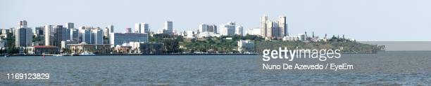 panoramic view of sea and buildings against clear sky - maputo city stock pictures, royalty-free photos & images