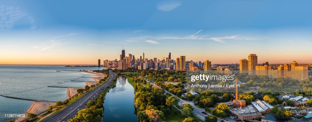 Panoramic View Of Sea And Buildings Against Sky During Sunset : Stock Photo
