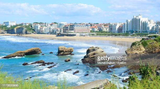 panoramic view of sea and buildings against sky - biarritz stock pictures, royalty-free photos & images