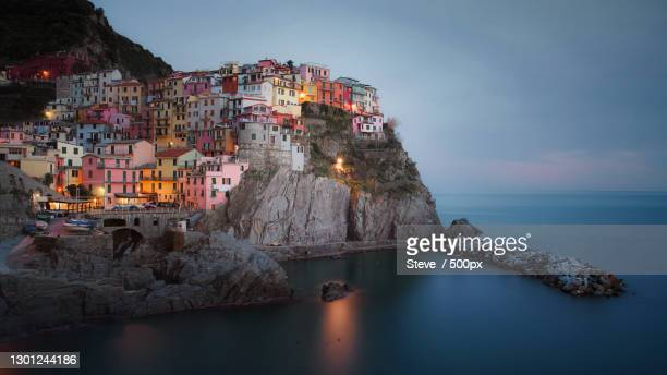 panoramic view of sea and buildings against sky - travel foto e immagini stock