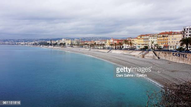 panoramic view of sea and buildings against sky - sahne ストックフォトと画像