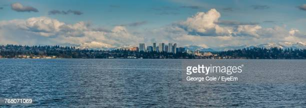panoramic view of sea and cityscape against sky - bellevue skyline stock pictures, royalty-free photos & images