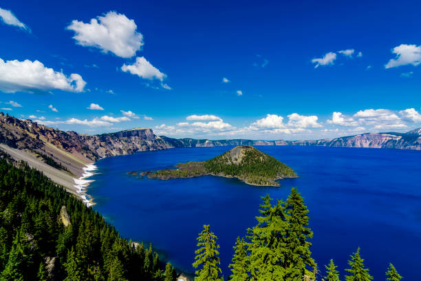 Panoramic view of sea and mountains against blue sky,Crater Lake National Park,Oregon,United States,USA