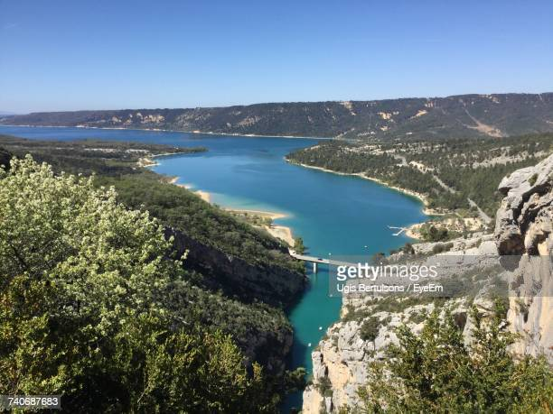 panoramic view of sea and mountains against clear blue sky - alpes de haute provence stock pictures, royalty-free photos & images